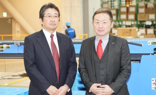 村田機械の柳井武則執行役員とホームロジスティクスの松浦学社長