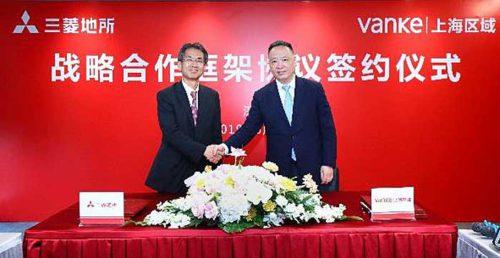 三菱地所の中島篤常務 (左)、万科企業の張海副総裁(右)