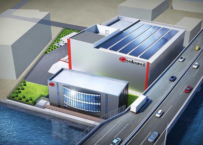 湾曲した窓の構造の建物が横浜みらいHRD(仮称)、後ろ側の建物が横浜みらいサテライト(仮称)